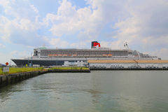 Queen Mary 2 cruise ship docked at Brooklyn Cruise Terminal. NEW YORK - JULY 1: Queen Mary 2 cruise ship docked at Brooklyn Cruise Terminal on July 1, 2014 Royalty Free Stock Image