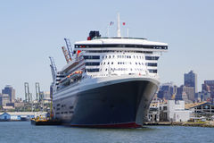 Queen Mary 2 cruise ship docked at Brooklyn Cruise Terminal. NEW YORK - JULY 6: Queen Mary 2 cruise ship docked at Brooklyn Cruise Terminal on July 6, 2014 Royalty Free Stock Photos