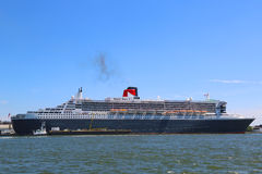 Queen Mary 2 cruise ship docked at Brooklyn Cruise Terminal. NEW YORK - JULY 6: Queen Mary 2 cruise ship docked at Brooklyn Cruise Terminal on July 6, 2014 Stock Images