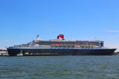 Queen Mary 2 cruise ship docked at Brooklyn Cruise Terminal. NEW YORK - JULY 6  Queen Mary 2 cruise ship docked at Brooklyn Cruise Terminal on July 6, 2014 Royalty Free Stock Image
