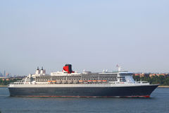 Queen Mary 2 cruise ship in New York Harbor heading for Canada and New England Royalty Free Stock Photos