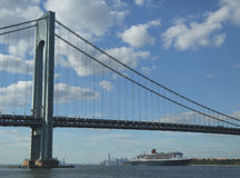 Queen Mary 2 cruise ship in New York Harbor under Verrazano Bridge heading for Transatlantic Crossing from New York to Southampton Royalty Free Stock Photo