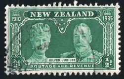 Queen Mary and King George V. NEW ZEALAND - CIRCA 1935: stamp printed by New Zealand, shows Queen Mary and King George V, circa 1935 Royalty Free Stock Photo
