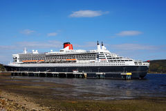 Queen Mary 2 in LaBaie. Queen Mary 2 cruise ship at the Bagotville wharf on the Saguenay fjord on October 8, 2016 Royalty Free Stock Photo