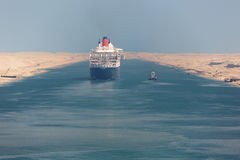 The Queen Mary 2 navigating through the Suez Canal. Editorial: ISMAILIA, EGYPT, April 27, 2017 - The Queen Mary 2 navigating through the Suez Canal in a ship Royalty Free Stock Photography