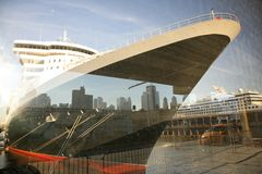 Queen Mary in new-york harbor. NY skyline mirroring in the window of passenger terminal Stock Images