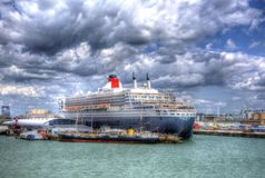 Queen Mary 2 ocean going transatlantic liner and cruise ship at Southampton Docks England UK. In colourful HDR with cloudscape Royalty Free Stock Photography