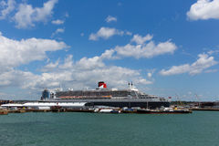 Queen Mary 2 ocean going transatlantic liner and cruise ship at Southampton Docks England UK. In summer with blue sky Royalty Free Stock Images