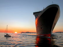 Queen Mary 2 in Vigo,Spain with sunset Stock Photo