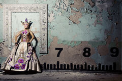 Queen near wall Royalty Free Stock Images