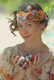 Queen needlewoman. Girl in the crown of sewing accessories holding coil of thread Royalty Free Stock Photo