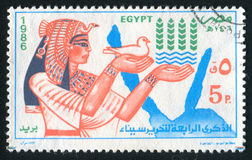 Queen Nefertiti. EGYPT - CIRCA 1986: stamp printed by Egypt, shows Queen Nefertiti, pigeon, map, circa 1986 Stock Photo