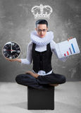 Queen of office, concept. Business lady in ruff collar with a clock, a graph and a pictured crown Royalty Free Stock Images