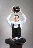 Queen of office, concept. Business lady in ruff collar with a clock looking at camera Royalty Free Stock Photos