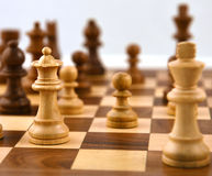 QUEEN AND PAWN ON THE CHESS BOARD Royalty Free Stock Photo