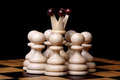 Queen and pawns Stock Photos