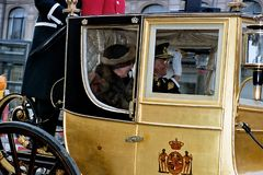 QUEEN AND PRINCE DROVE IN ROYAK CARRIAGE. Copenhagen /Denmark - 06 January 2004 _Queeb Margrethe and Prince hernik drove in royal carriage for new years rception royalty free stock photography