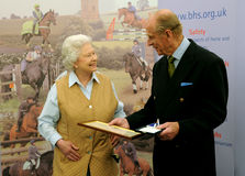 Queen and Prince Philip. The Queen of England presents her husband Prince Philip with an award Stock Photo