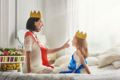Queen and princess in gold crowns Stock Photos