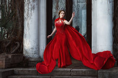 Queen in the red cloak. Fashion shot Royalty Free Stock Photos