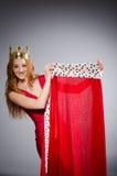 Queen in red dress Stock Photos