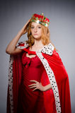 Queen in red dress Stock Photo