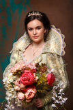 Queen in royal dress. With flowers Royalty Free Stock Photos