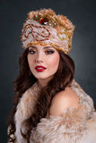 Queen in royal dress. sexy girl in royal hat and fur coat. Beautiful haughty queen in royal dress. sexy girl in royal hat and fur coat Stock Photos