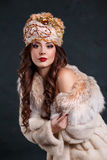 Queen in royal dress. sexy girl in royal hat and fur coat. Beautiful haughty queen in royal dress. sexy girl in royal hat and fur coat Stock Image