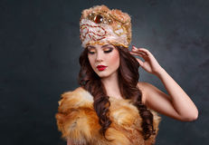 Queen in royal dress. sexy girl in royal hat and fur coat Royalty Free Stock Photo