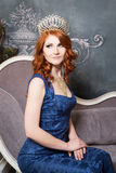 Queen, royal person with crown, red hair in blue violet dress Stock Images