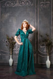 Queen, royal person with crown, red hair and green dress royalty free stock photo