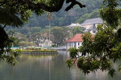 The Queen`s bathing house on lake Kandy - Sri lanka. The Ulpange or the Queen's Bathing Pavilion is situated partly in the waters of the Kandy Lake and stock image