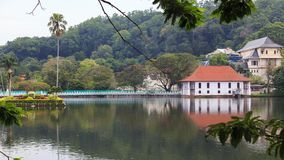The Queen`s bathing house on lake Kandy - Sri lanka. The Ulpange or the Queen's Bathing Pavilion is situated partly in the waters of the Kandy Lake and royalty free stock image