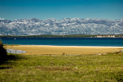 Queen's beach in Nin, Croatia. Queen's sand beach in Nin and Velebit mountain, Croatia Royalty Free Stock Photos