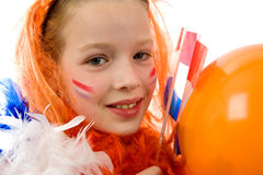Queen's day. Young girl is posing in orange with balloon and flag, isolated on white stock photo