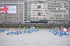The Queen's Diamond Jubilee Pageant. Sea Cadets carrying the flags of the Commonwealth, part of the Flotilla of a 1,000 boats watched by large crowds in the Stock Photography