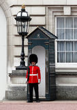 The Queen`s Guard on duty at Buckingham Palace, the official residence of the Queen of Engla. London, England, UK - April 25, 2010: The Queen`s Guard on duty at royalty free stock photography