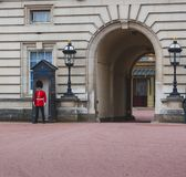 Queen`s Guard standing outside of Buckingham Palace. LONDON, UNITED KINGDOM - August, 20th, 2015: Queen`s Guard standing outside of Buckingham Palace Royalty Free Stock Image