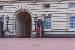 Queen`s Guard standing outside of Buckingham Palace. LONDON, UNITED KINGDOM - August, 20th, 2015: Queen`s Guard standing outside of Buckingham Palace Stock Images