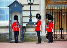 Queen's Guards at the Buckingham palace in London, UK Stock Images
