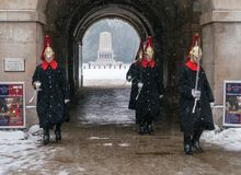 Queen`s Guards on Snowy Day stock image