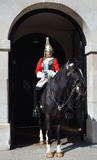 Queen's Horse Guards. The Household Cavalry Mounted Regiment entrance on Whitehall.The HCMR Squadron of The Life Guards wear red tunics and white plumed helmets Stock Photography