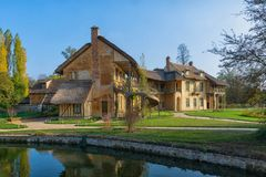 The Queen`s house in the hamlet in the park of Trianon stock photo