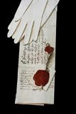 Queen's letter. With white gloves.  Black background Stock Photography