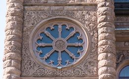 Queen's Park Building Architectural Detail. Richardsonian Romanesque architecture: Round window with a pattern on the facade of the Ontario Legislative Building Stock Photography