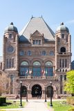 Queen's Park Building in daytime. Queen's Park building seat of the Ontario Provincial Government. The Ontario Legislative Building which houses the viceregal Stock Images