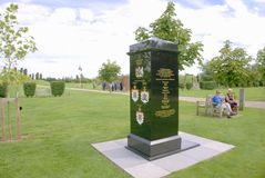Queen`s regiment memorial. Queen`s regiment memorial with history inscription in gold and regiment badges. This memorial is at the National memorial arboretum Royalty Free Stock Photography
