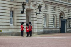 Queen`s Royal guards on duty at Buckingham Palace, London England royalty free stock image