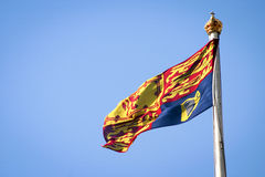The Queen's Royal Standard. The Queen's flag, the Royal Standard, which can only be flown to indicate the presence of her majesty Royalty Free Stock Photography